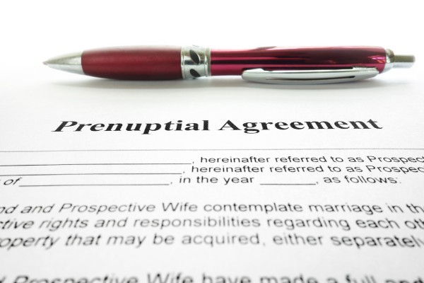 pen sitting on prenuptial agreement paperwork